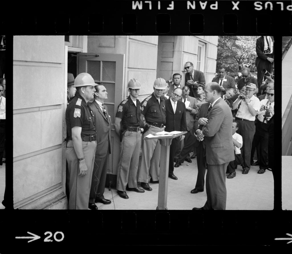 Governor George Wallace attempting to block Integration by standing defiantly at Door while being confronted by Deputy U.S. Attorney General Nicholas Katzenbach, University of Alabama, Tuscaloosa, Alabama,