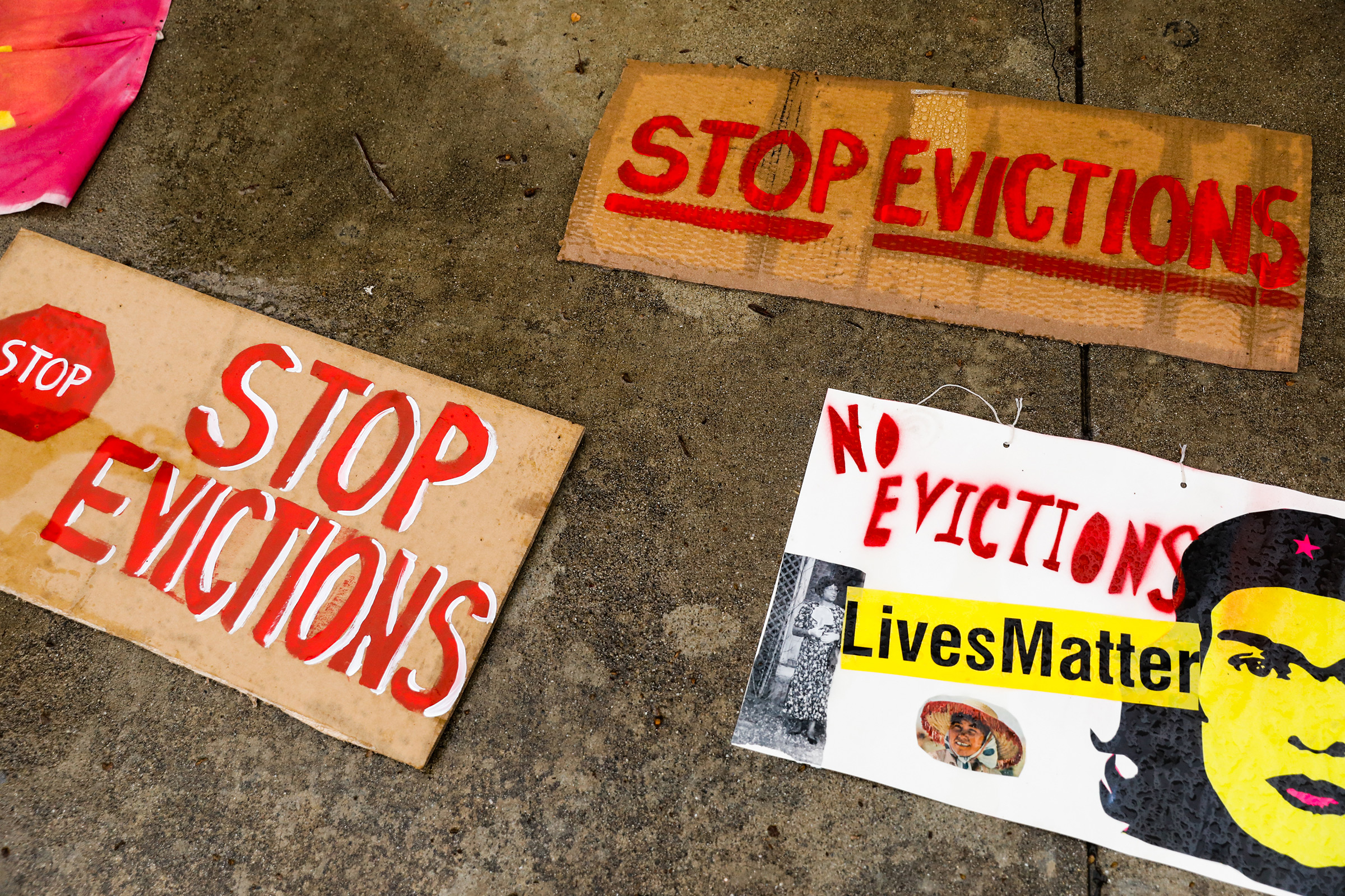 Signage lays on the ground during a protest outside the Santa Clara County Courthouse in San Jose to halt eviction proceedings from taking place on Jan. 27. Although rent moratoriums were instituted to help people who lost their jobs due to coronavirus shutdowns, certain types of eviction actions are still going forward.