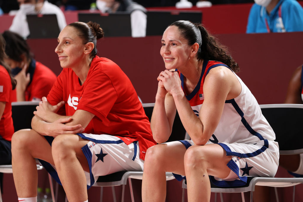 Sue Bird #6 and Diana Taurasi #12 of Team USA react in celebration from the bench during the second half of the women's basketball final game between the U.S. and Japan at the Tokyo Olympic games at Saitama Super Arena on Aug. 08, 2021 in Saitama, Japan.