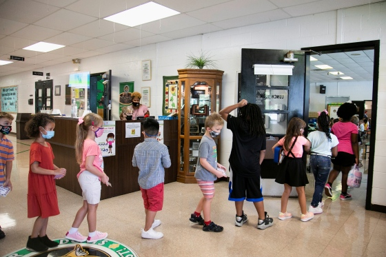 Students walk to the school cafeteria for lunch at Wilder Elementary School in Louisville, Ky. on Aug. 11.