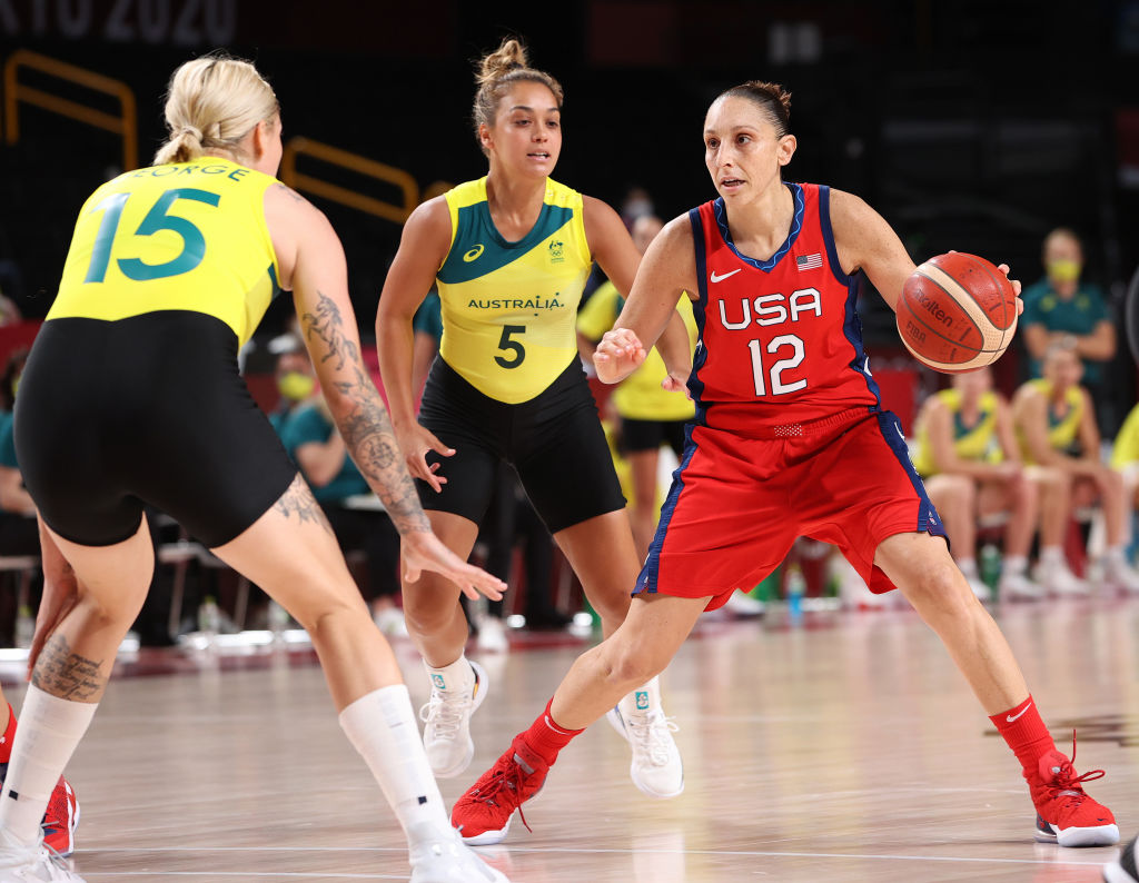 Diana Taurasi #12 of Team USA moves the ball up court against Cayla George #15 of Team Australia during the first half of a Women's Basketball Quarterfinals game on day twelve of the Tokyo 2020 Olympic Games at Saitama Super Arena in Saitama, Japan on August 04, 2021.