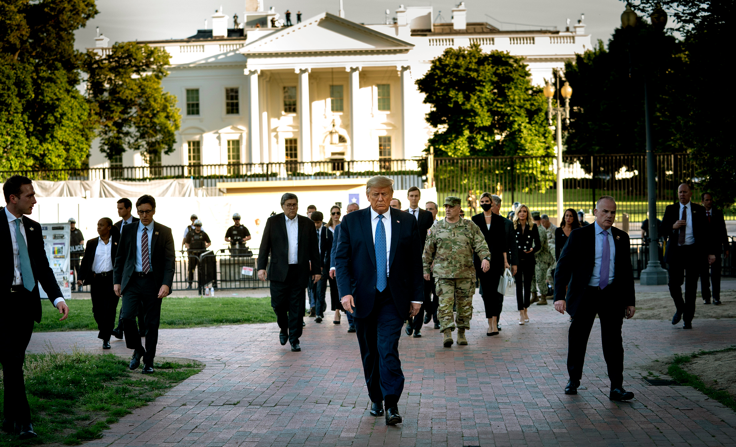 President Donald Trump, trailed by a group that includes Gen. Mark Milley, walks to St. John's Church after security forces cleared Lafayette Square near the White House on June 1, 2020.