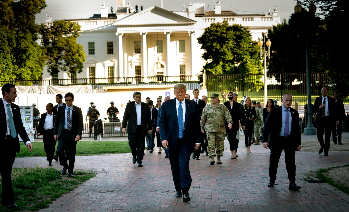 President Donald Trump, trailed by a group including along with Gen. Mark Milley, walks to St. John's Church after security forces cleared Lafayette Square near the White House on June 1, 2020.