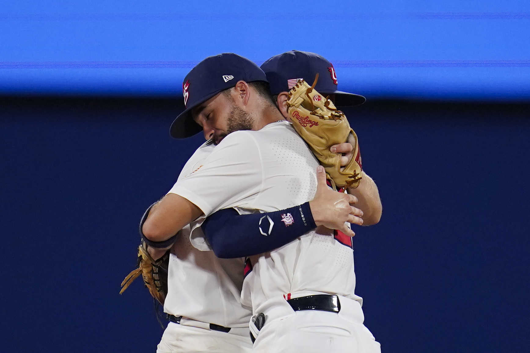 Team USA's Eddy Alvarez, front, and Nick Allen embrace after a semi-final baseball game against South Korea at the 2020 Summer Olympics, Thursday, Aug. 5, 2021, in Yokohama, Japan. The United States won 7-2.