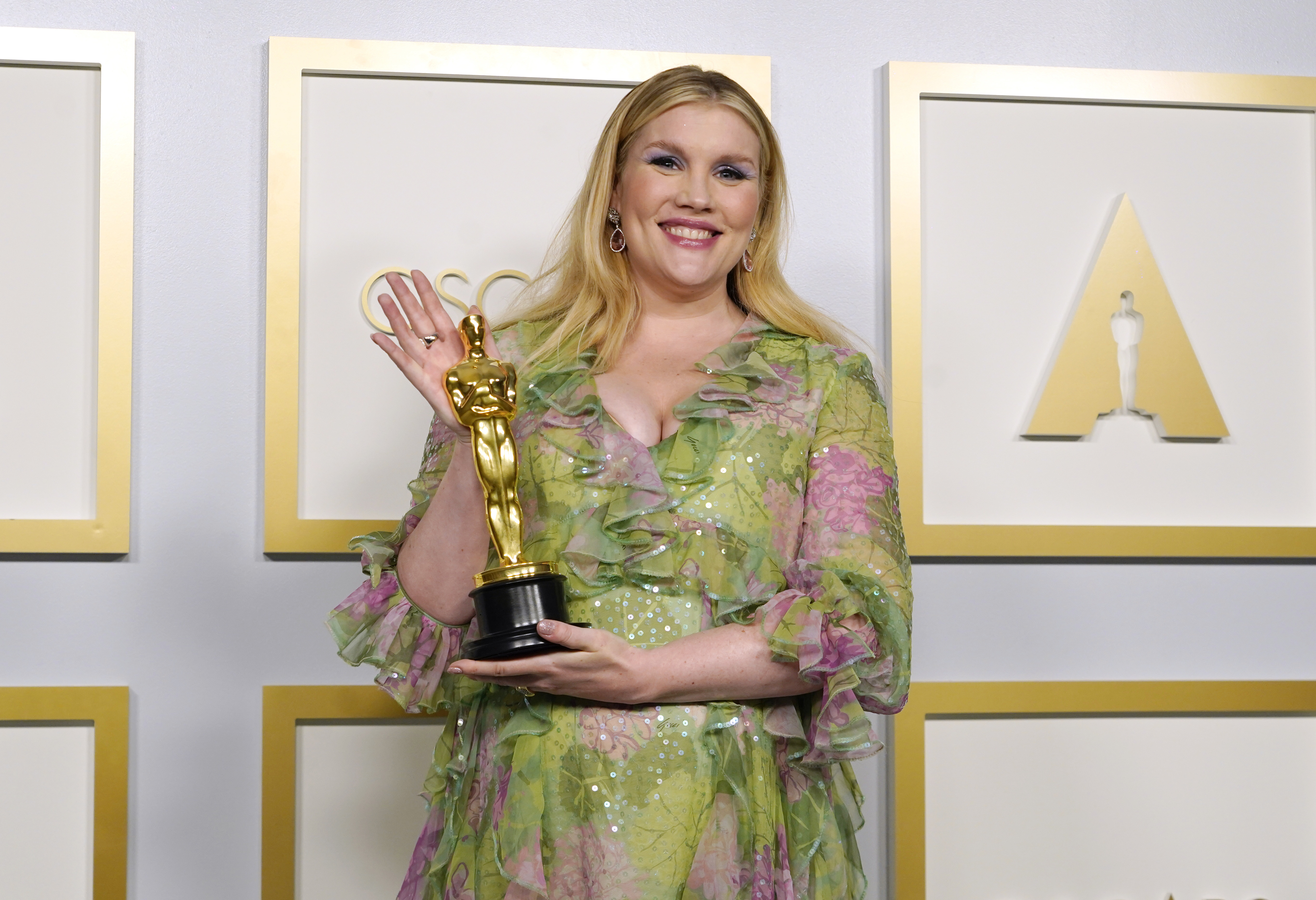Emerald Fennell, winner of Best Original Screenplay for  Promising Young Woman,  poses at the Oscars on Sunday, April 25, 2021