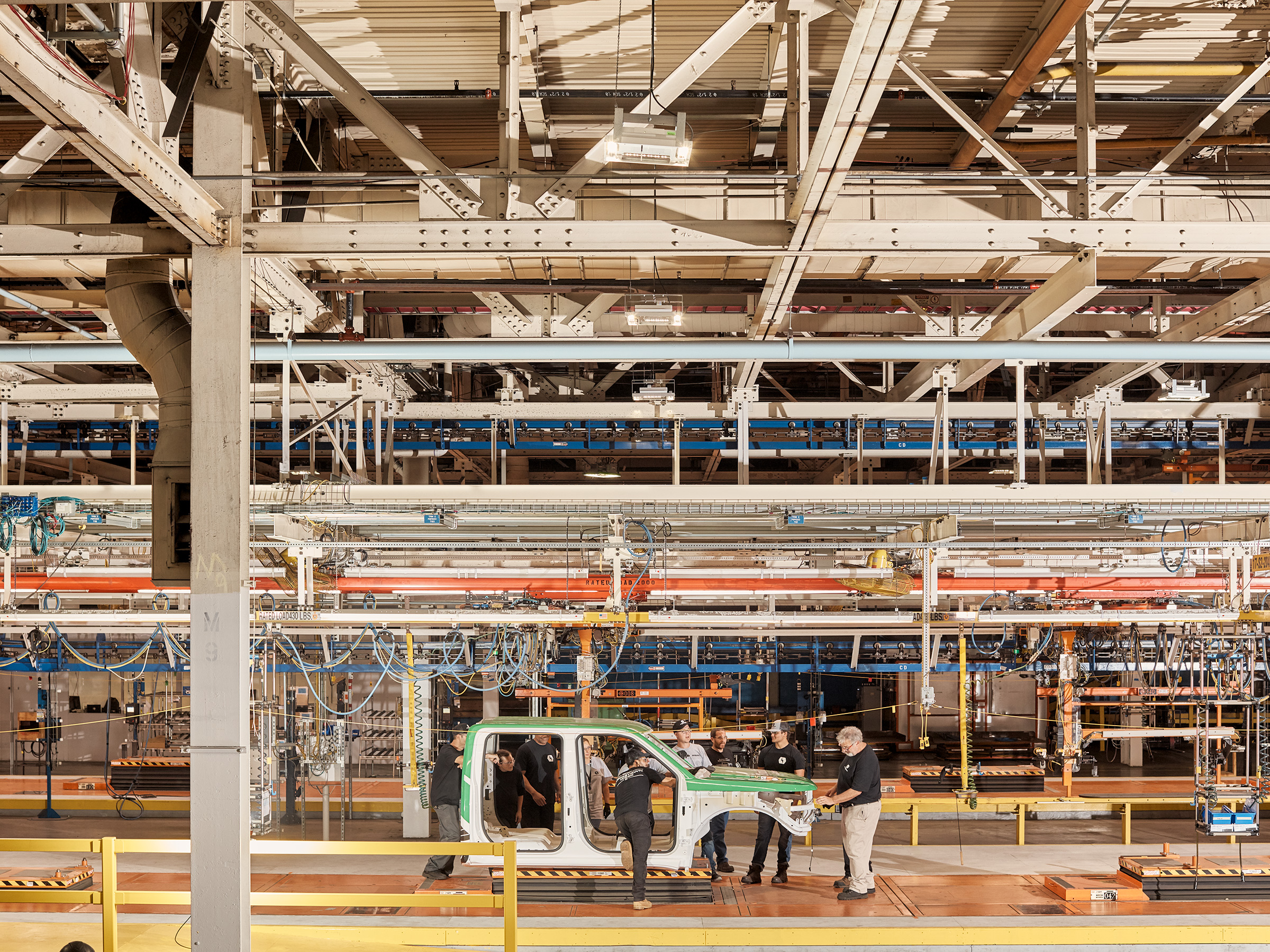 Lordstown Motors employees stand at the company's Ohio assembly line