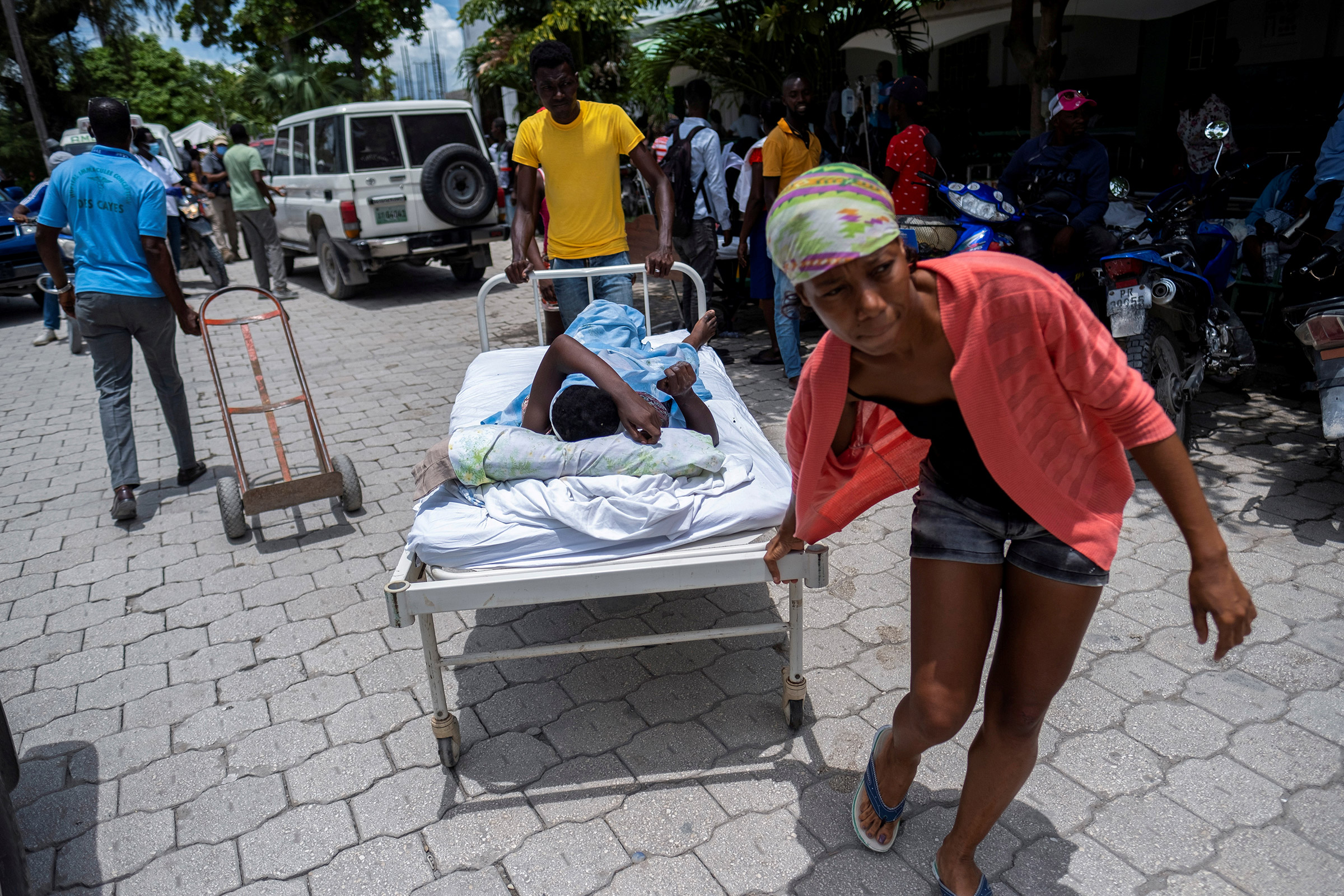 A woman injured in the earthquake is transported to a hospital in Les Cayes on Aug. 16.