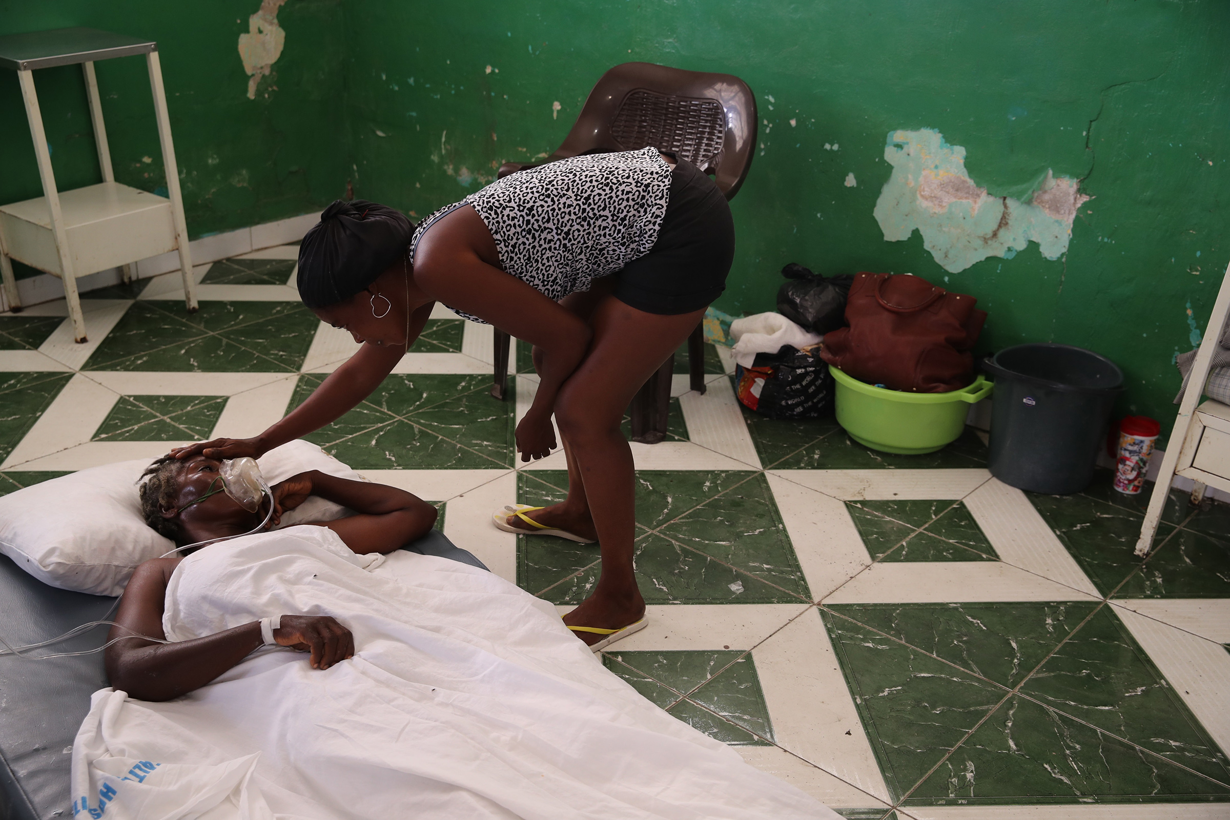 Some of those injured during the earthquake are assisted in corridors or on floors of the general hospital due to the lack of available beds in Les Cayes on Aug. 16.