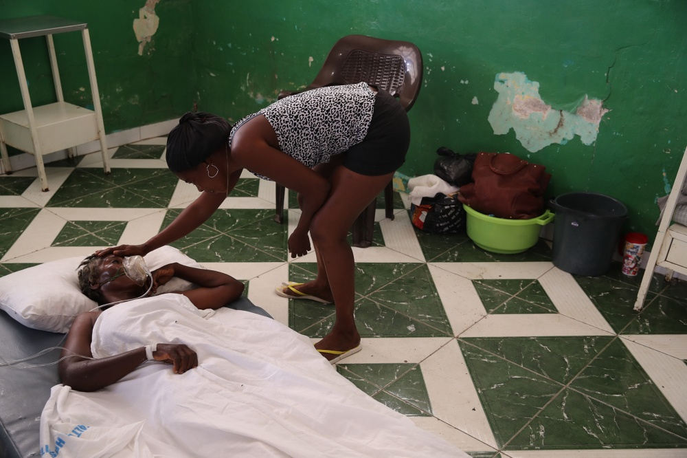Some of those injured during the earthquake are assisted in corridors or on the floors of the general hospital due to the lack of available beds in Les Cayes, Haiti, Aug. 16.