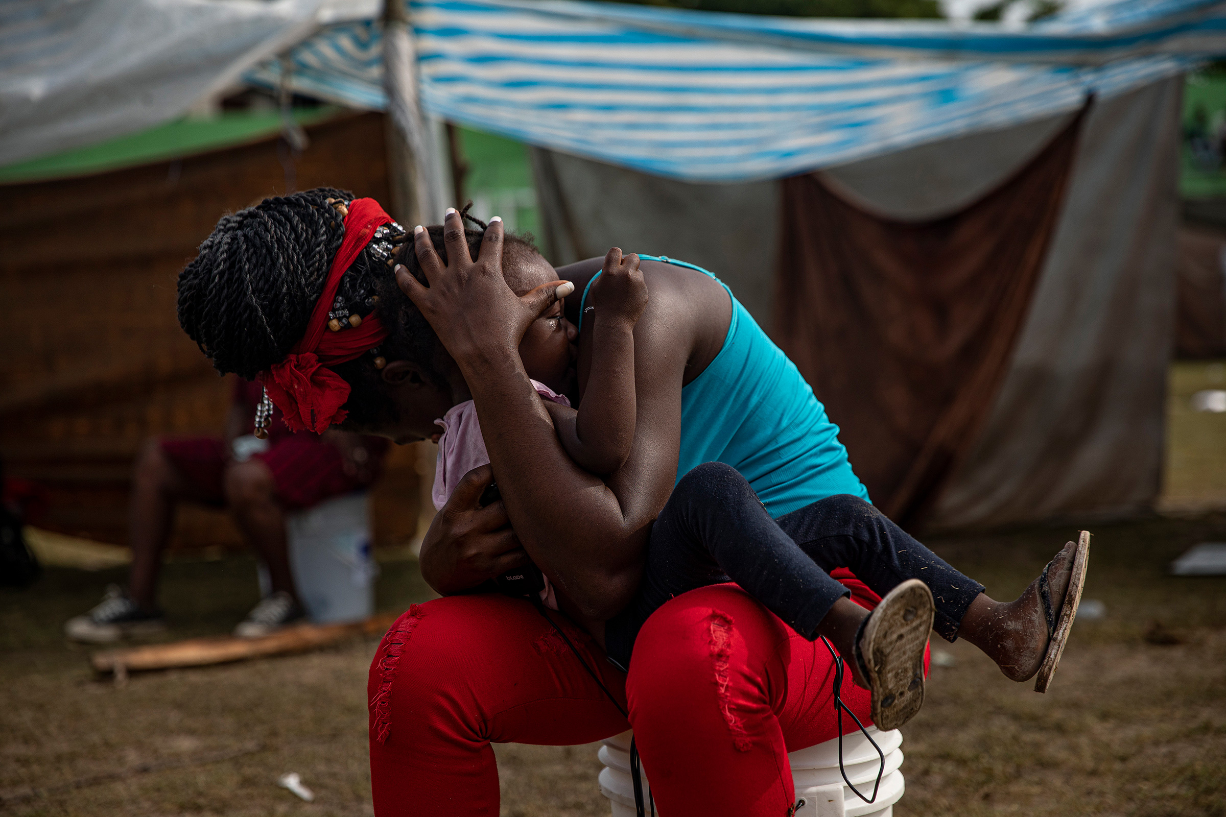 People displaced by the earthquake at a makeshift tent camp in Les Cayes on Aug. 19.