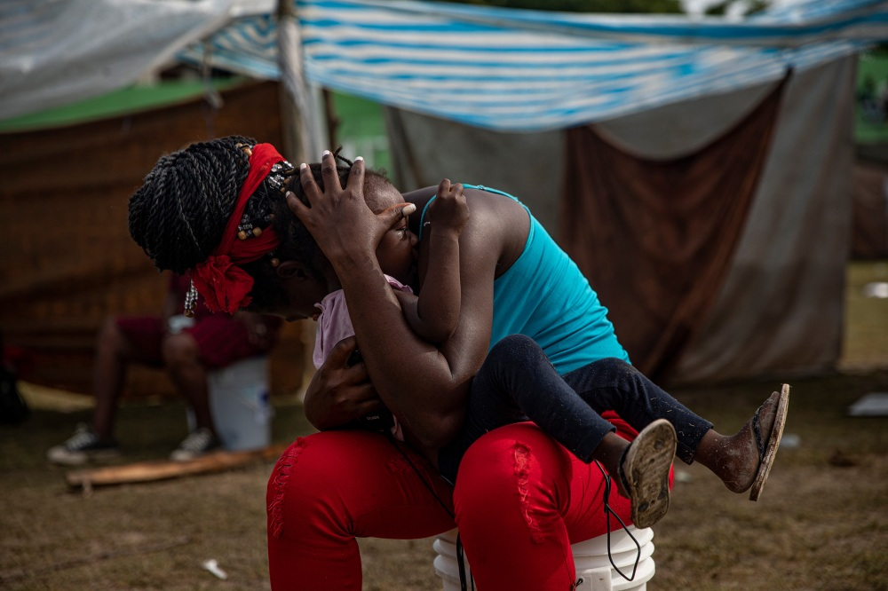 People displaced by the earthquake now living at a makeshift tent camp in Les Cayes, Haiti, Aug. 19.