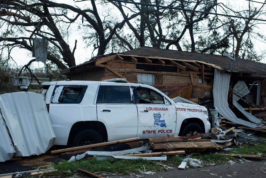 A damaged Louisiana State Police car is seen next to a  destroyed house in Little Caillou, near Montegut, Louisiana on August 30, 2021 after Hurricane Ida made landfall. As Hurricane Ida made its way through Louisiana and Mississippi, the New Orleans police department prioritized the protection of property after announcing they would be deploying  anti-looting  teams in the city, something local activists have strongly criticized.