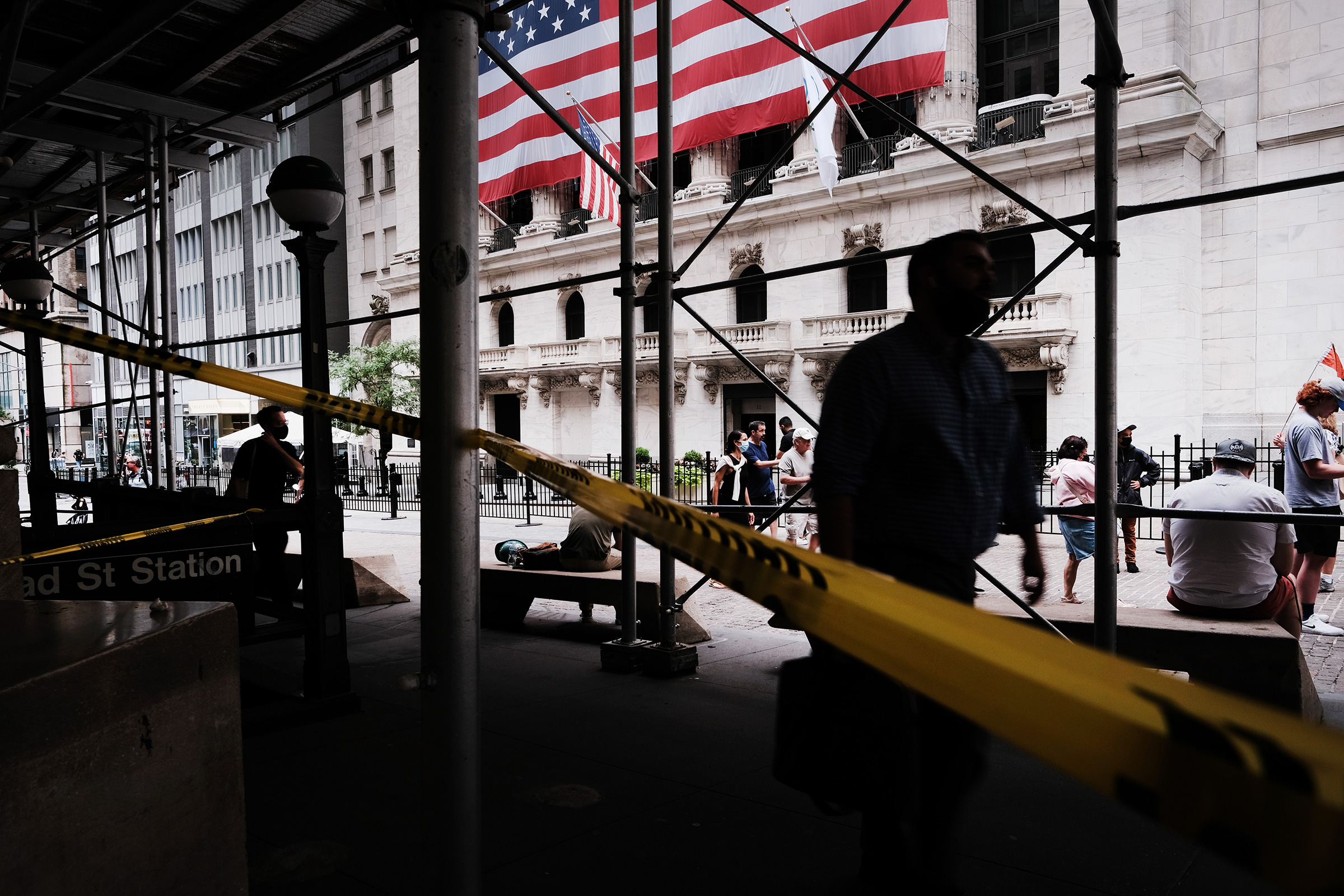 People walk by the New York Stock Exchange in New York City on Aug. 10, 2021
