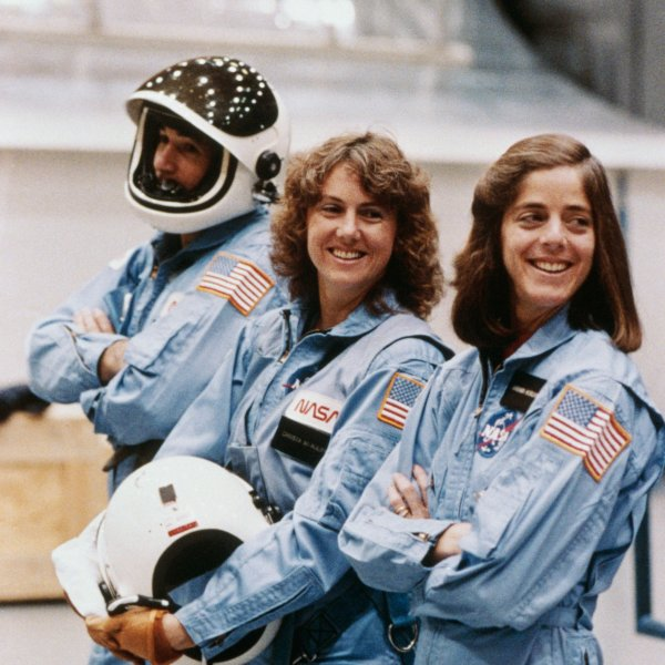 Payload specialists in training for STS-51L take a break in shuttle emergency egress training in 1986. Left to right: Gregory Jarvis, Christa McAuliffe and Barbara Morgan. McAuliffe was selected as NASA's first citizen observer in the Space Shuttle Program and Morgan was named her backup.