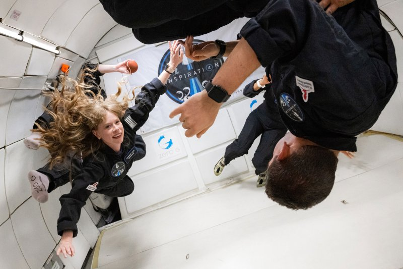 Hayley Arceneaux (left) and the rest of the Inspiration4 crew on a ZERO-G flight in Las Vegas on July 11, 2021. The plane flies in parabolic arcs to simulate zero gravity.