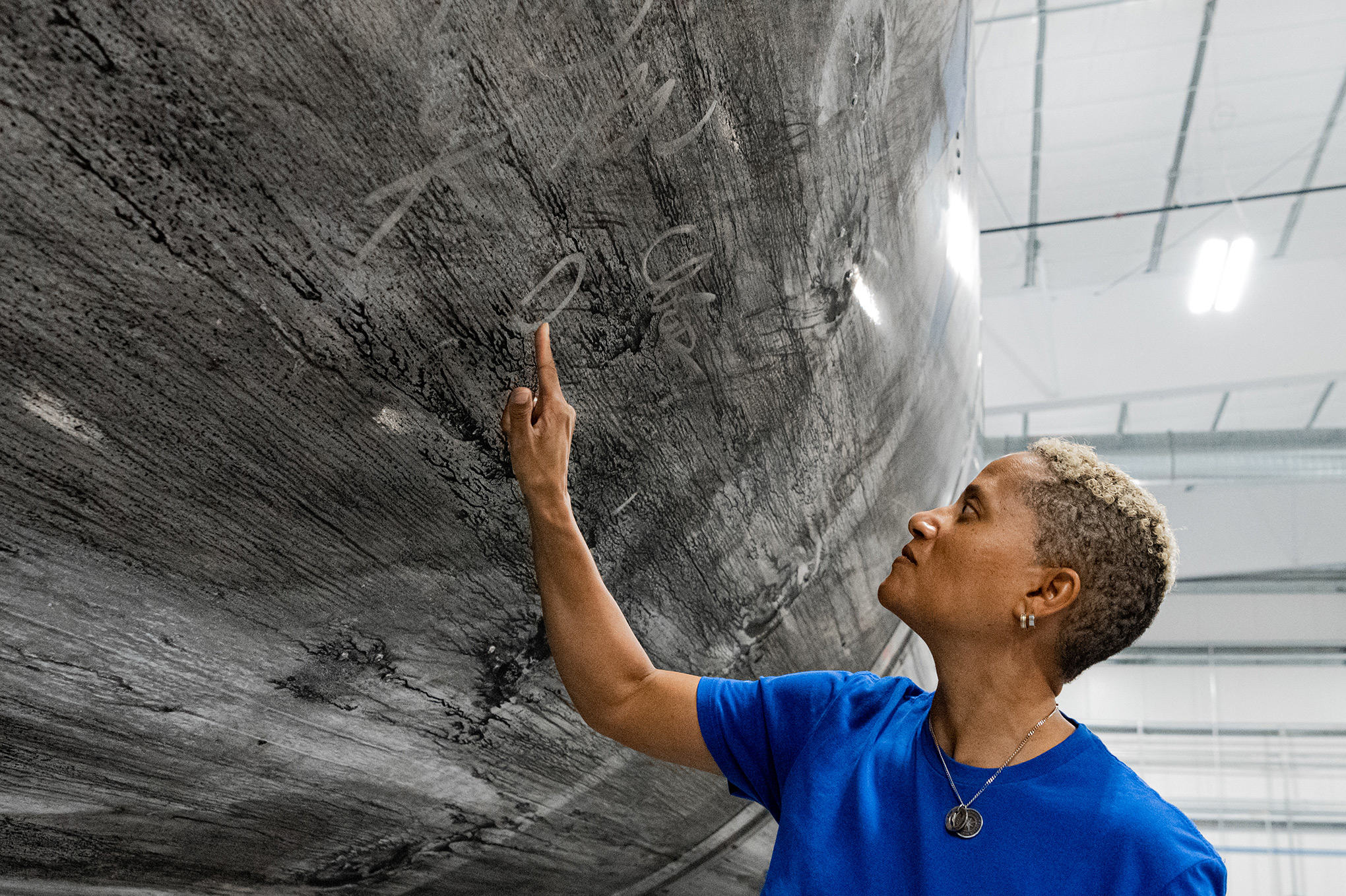 Dr. Sian Proctor signing the Falcon 9 reusable rocket booster that will launch the Inspiration4 crew into space. It has become a new tradition for SpaceX crews to sign their reusable vehicles.