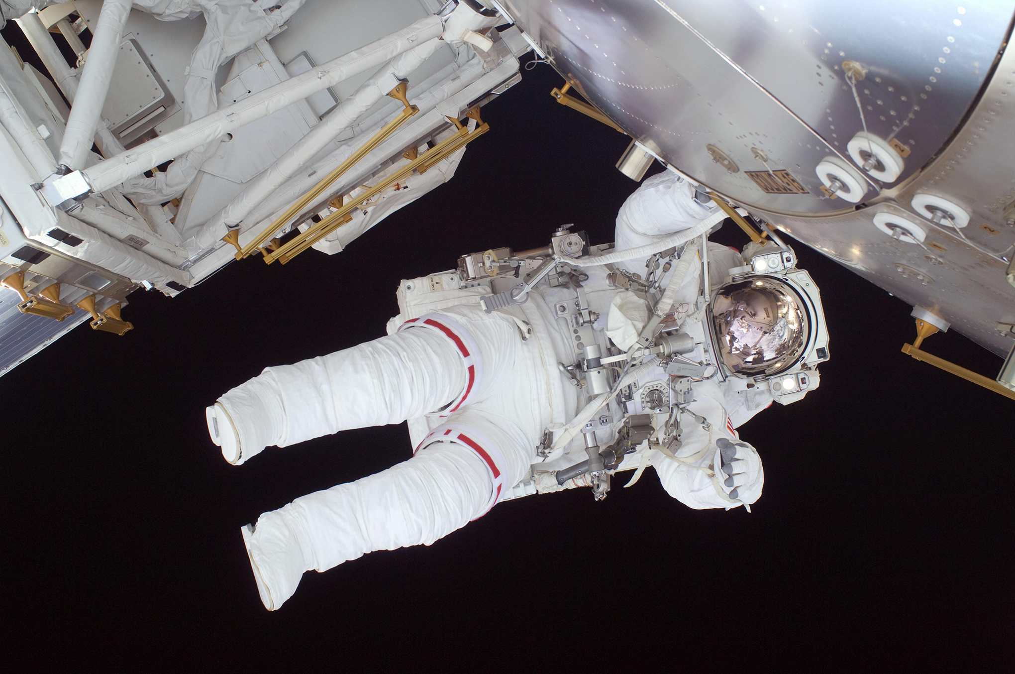 Expedition 20 flight engineer Nicole Stott participates in the STS-128 mission's first spacewalk as construction and maintenance continue on the International Space Station in 2009.