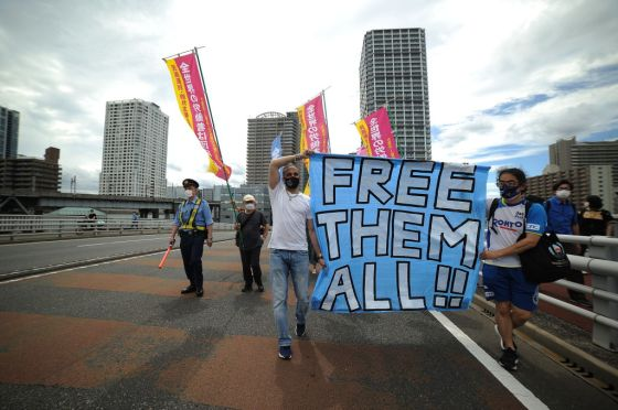 Protest march against Japan Immigration Services Agency on World