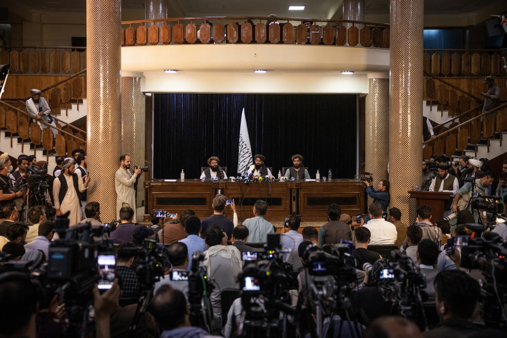 Zabihullah Mujahid, the Taliban's spokesperson, addresses reporters on Aug. 17 during the group's first news conference since gaining control of Kabul.