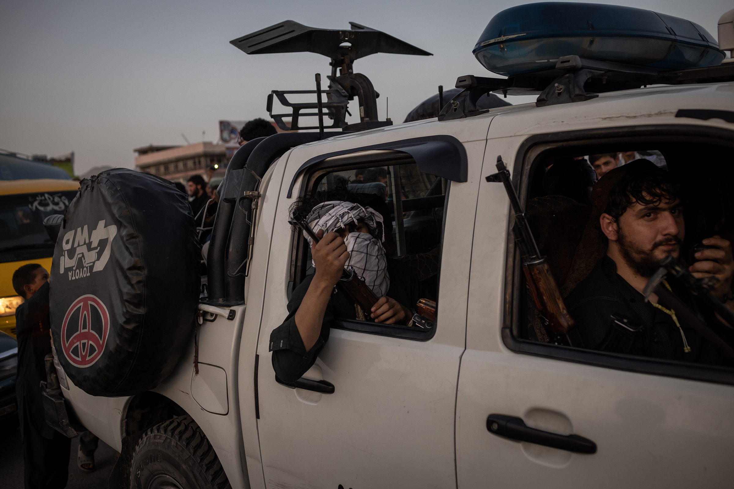 Taliban fighters drive into Kabul on Aug. 15.