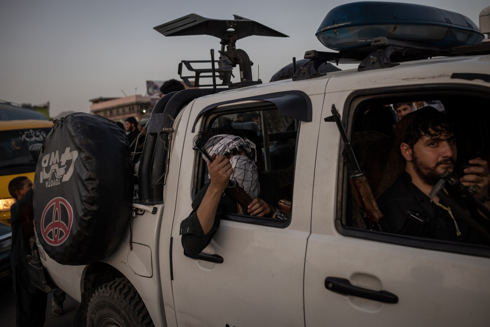 Taliban fighters drive into Kabul on Aug. 15, 2021.
