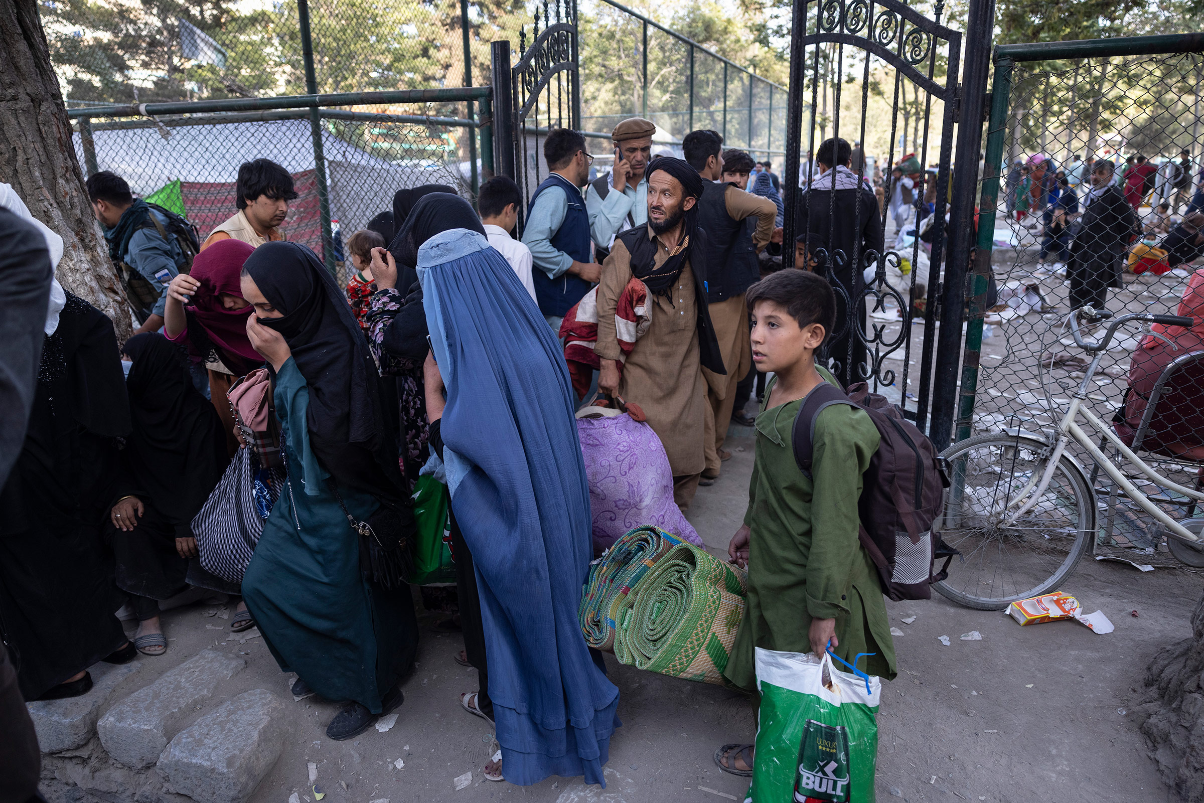 Displaced Afghans from the northern provinces are evacuated from a makeshift IDP camp to various mosques and schools in Kabul, Afghanistan on Aug. 12, 2021.