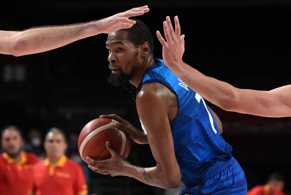 Team USA's Kevin Durant looks for pass during the men's quarter-final basketball match between Spain and USA of the Tokyo 2020 Olympic Games at the Saitama Super Arena in Saitama on August 3, 2021.
