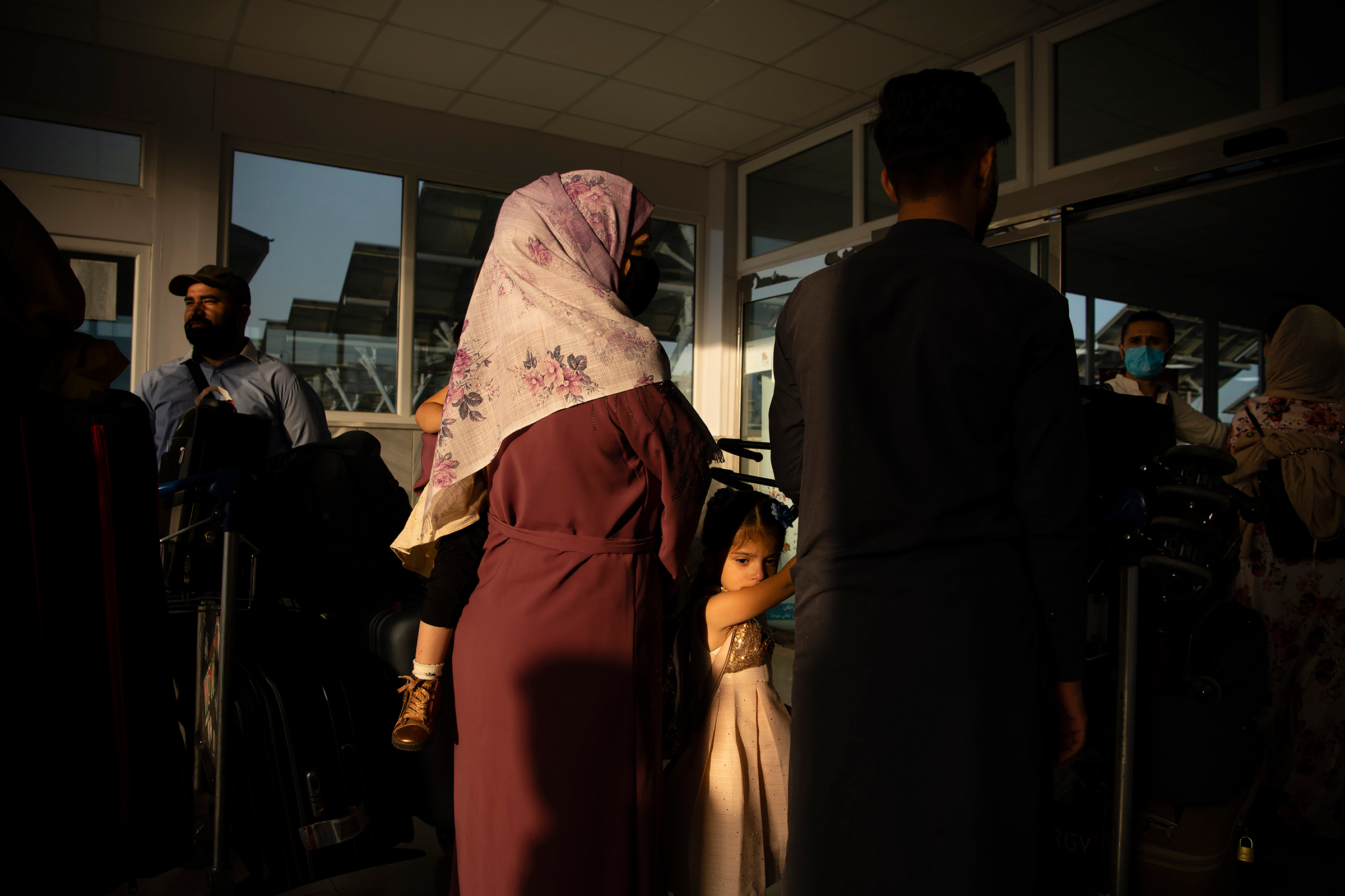Ahead of the Taliban's arrival, Afghans and travelers pass through checkpoints at Hamid Karzai International Airport in Kabul on Aug. 15.
