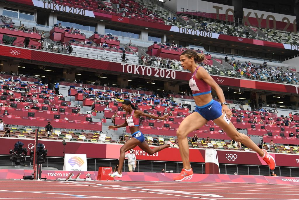 Team USA's Sydney Mclaughlin wins the women's 40-0m hurdles final ahead of Teaam USA's Dalilah Muhammad setting a new world record during the Tokyo 2020 Olympic Games at the Olympic Stadium in Tokyo on Aug. 4, 2021.