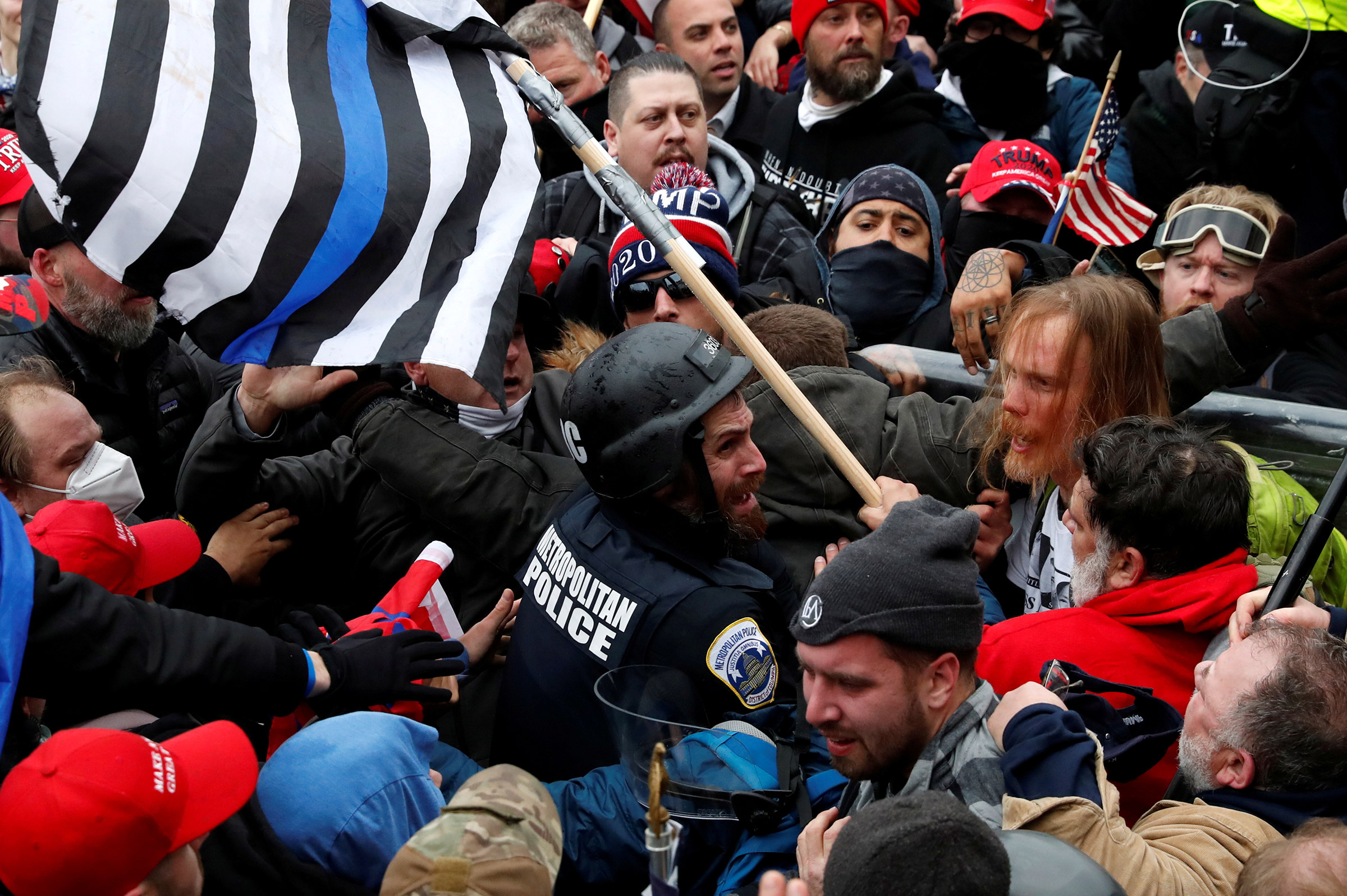 Fanone, in uniform and helmet, was nearly killed on Jan. 6 by a pro-Trump mob waving Thin-Blue-Line flags.