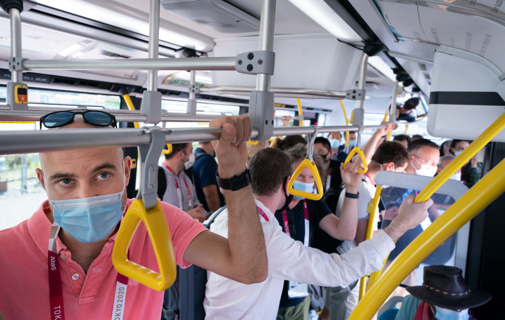Members of the media on a packed media bus in Tokyo ahead of the Tokyo 2020 Olympic Games in Japan. Picture date: Friday July 23, 2021.