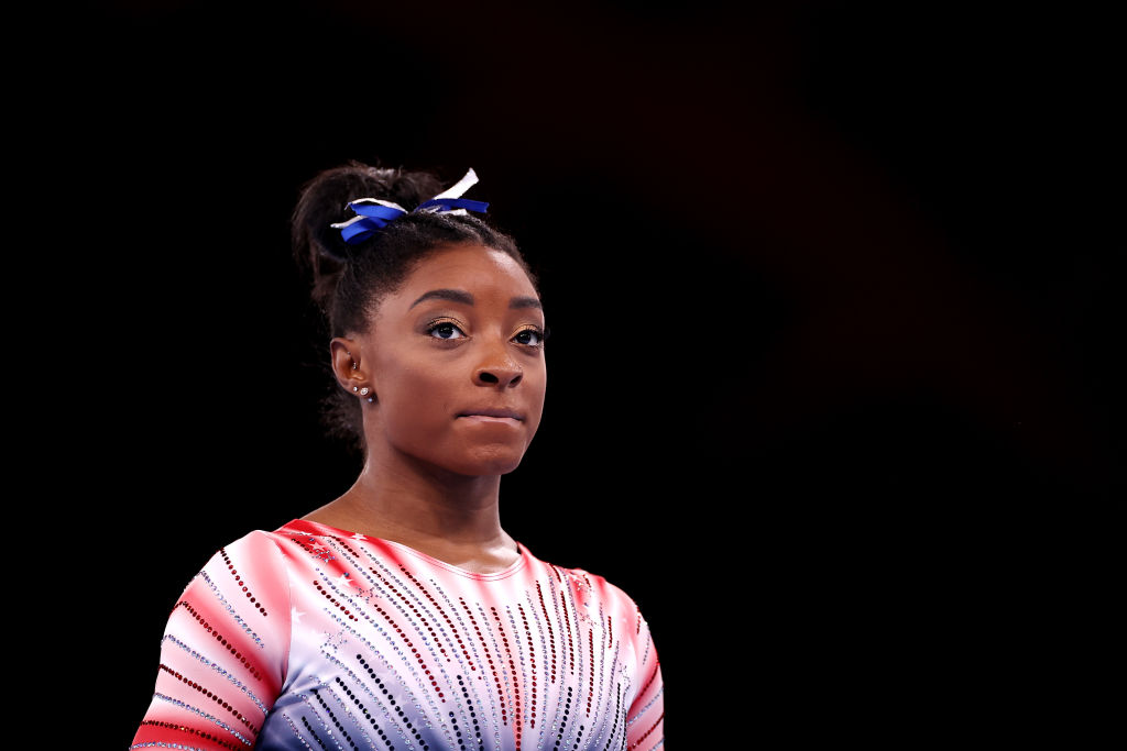 Simone Biles of Team USA looks on as she warms up prior to the Women's Balance Beam Final at the Tokyo 2020 Olympic Games at Ariake Gymnastics Centre on Aug. 03, 2021 in Tokyo, Japan.