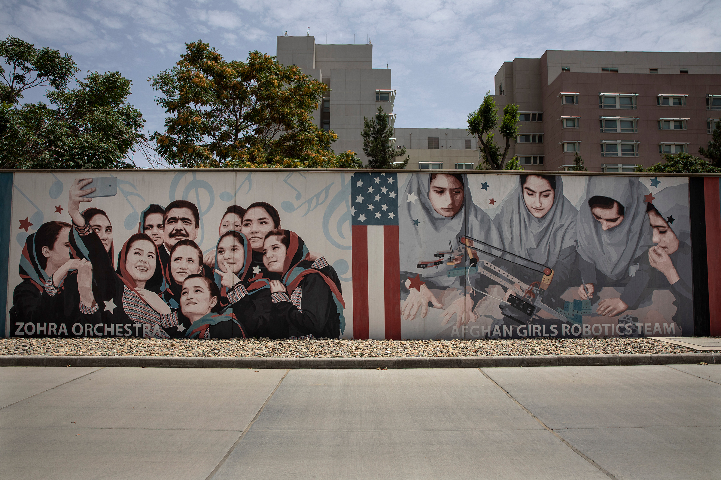 Murals are seen along the walls at the U.S. embassy in Kabul on July 30. In August, as the Taliban approached, staffers at the embassy scrambled to leave.
