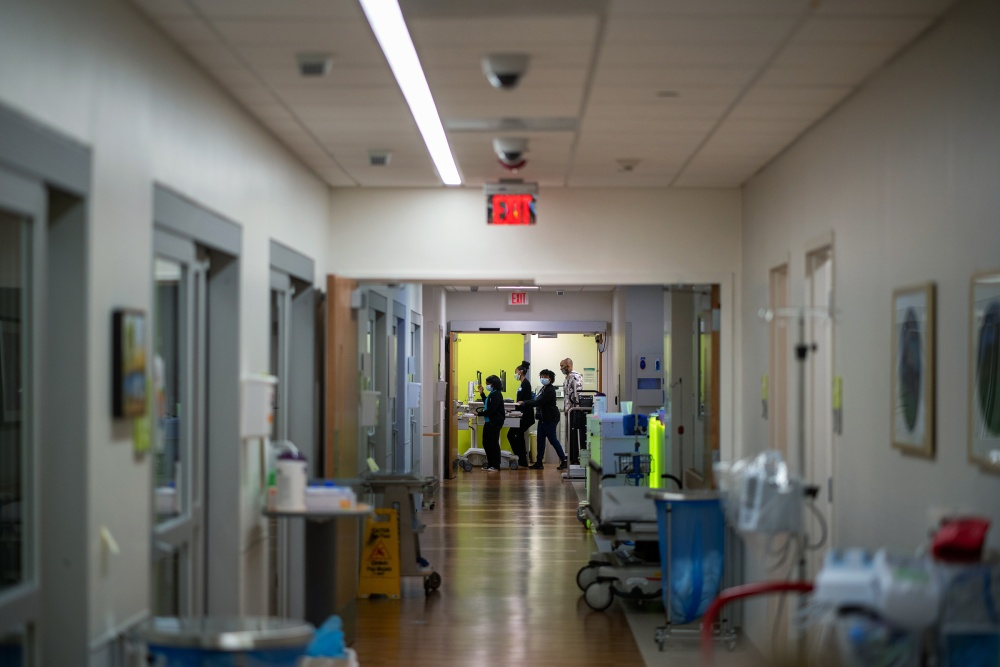 Medical workers line a hall at Children's Hospital New Orleans. The hospital has hired about 150 new nurses to help manage high patient counts.
