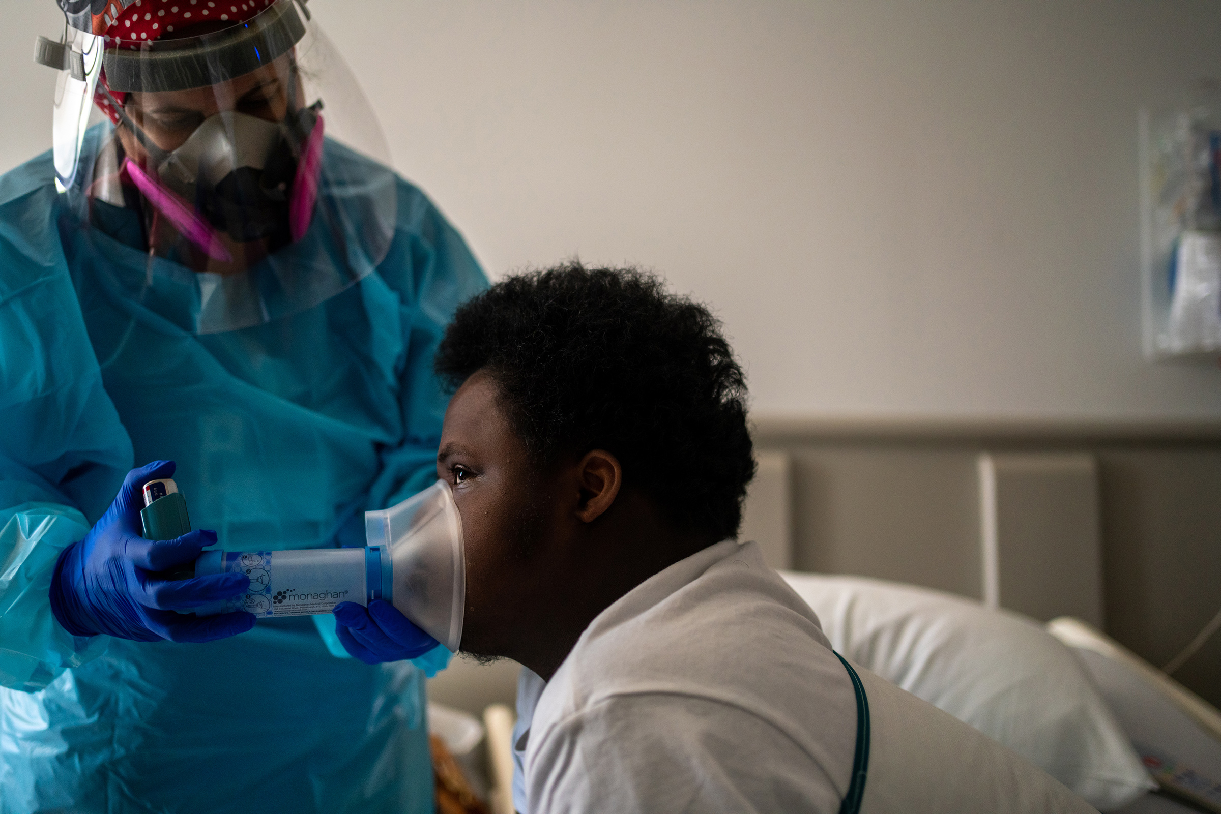 Nelson Alexis III, 17, undergoes respiratory therapy in his room at Children's Hospital New Orleans. Nelson, who has Down syndrome, was diagnosed with the virus in late July.