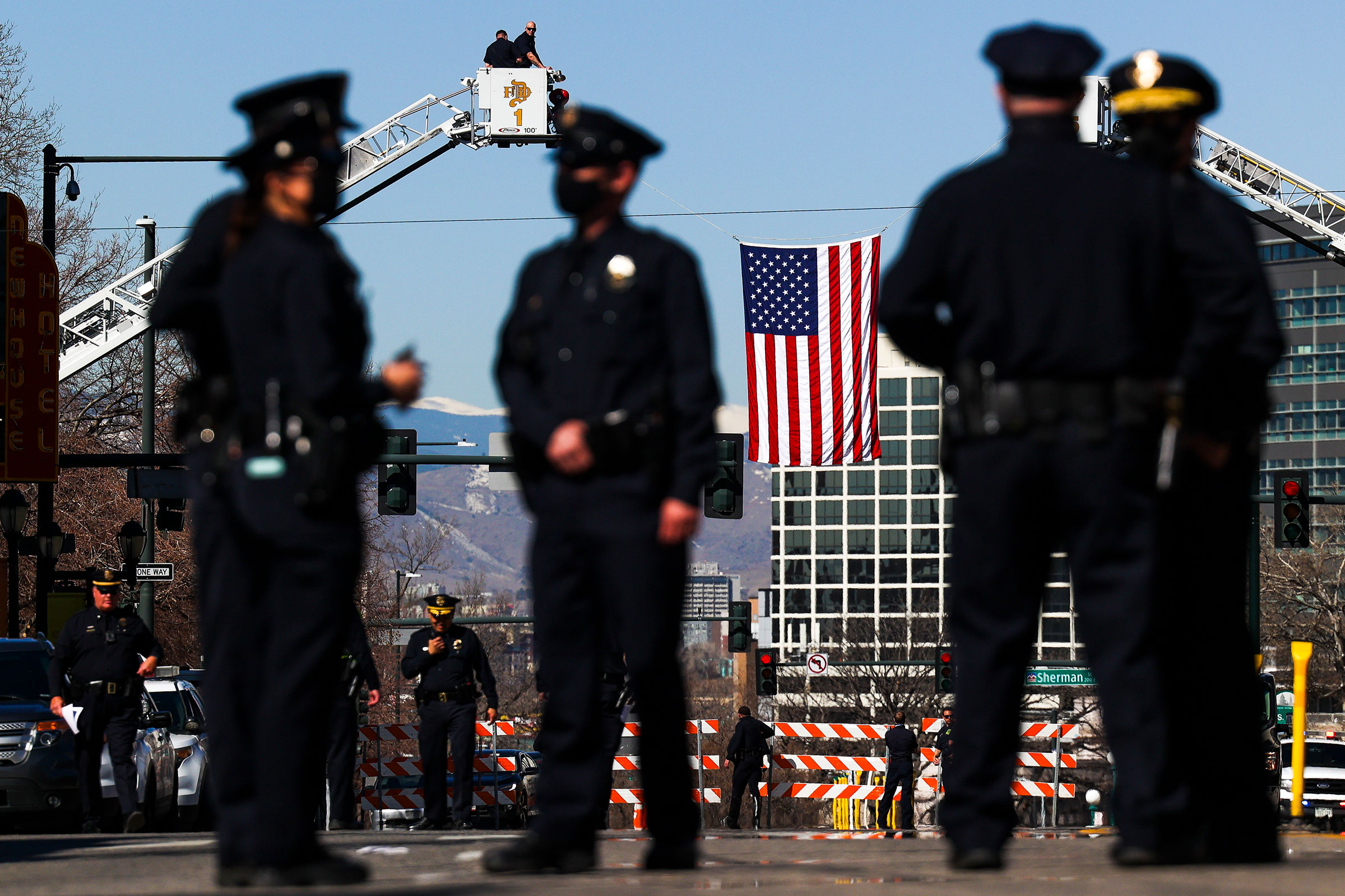 An American flag flies near the Cathedral Basilica of the Immaculate Conception during a funeral mass for slain Boulder Police officer Eric Talley on March 29, 2021 in Denver, Colorado.