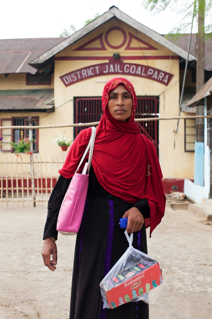 Samiran Nesa outside Goalpara district jail, where she is visiting her husband, Sohidul Islam, and carrying shoes to give him. He has been detained since December 2019, after a foreigners tribunal declared him an illegal immigrant.
