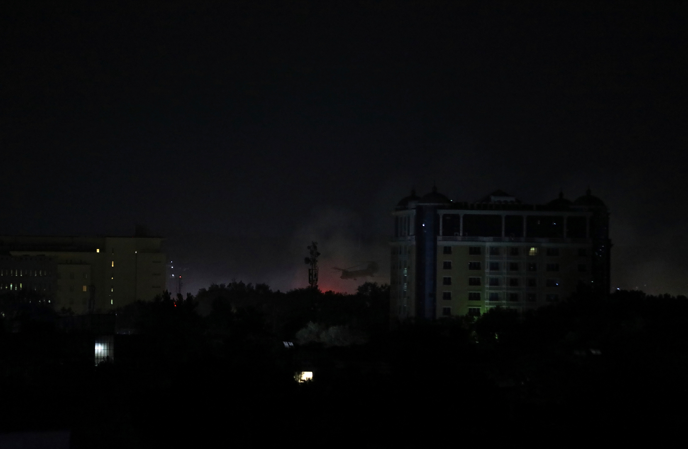 Smoke rises next to the U.S. Embassy in Kabul late on Aug. 15.