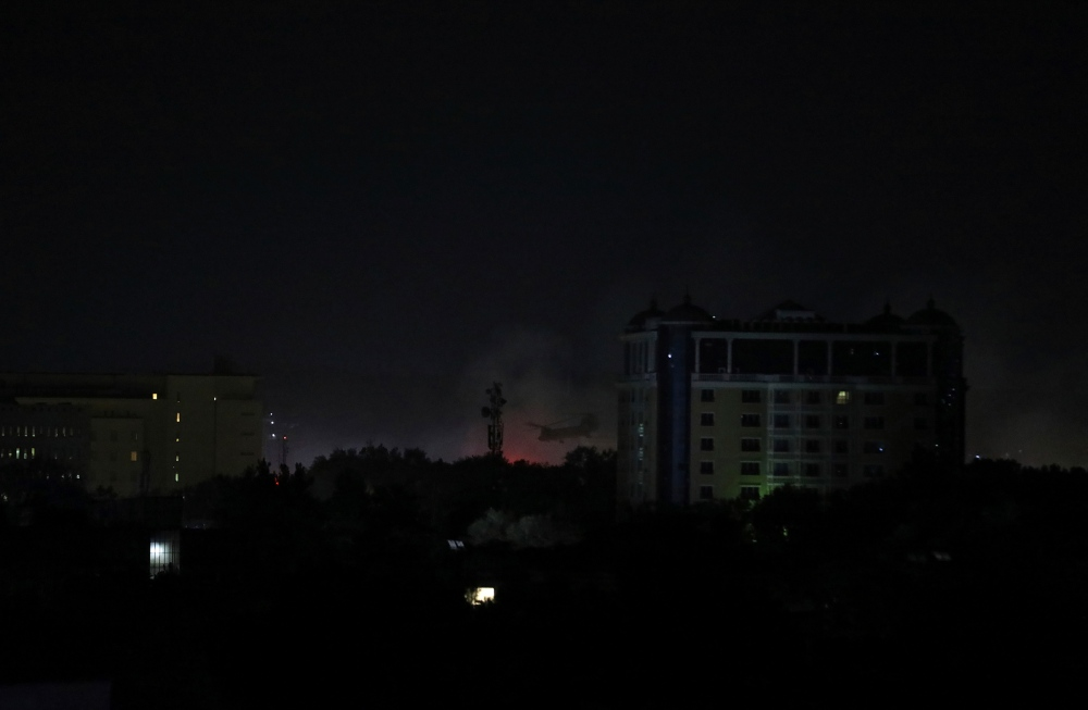 Smoke rises next to the U.S. Embassy in Kabul late on Aug. 15, 2021.