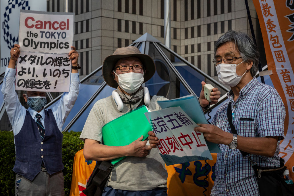 Anti-Olympics protesters demonstrate against the Tokyo Olympic in front of the Tokyo Metropolitan government building in Tokyo, Japan on August 05, 2021.