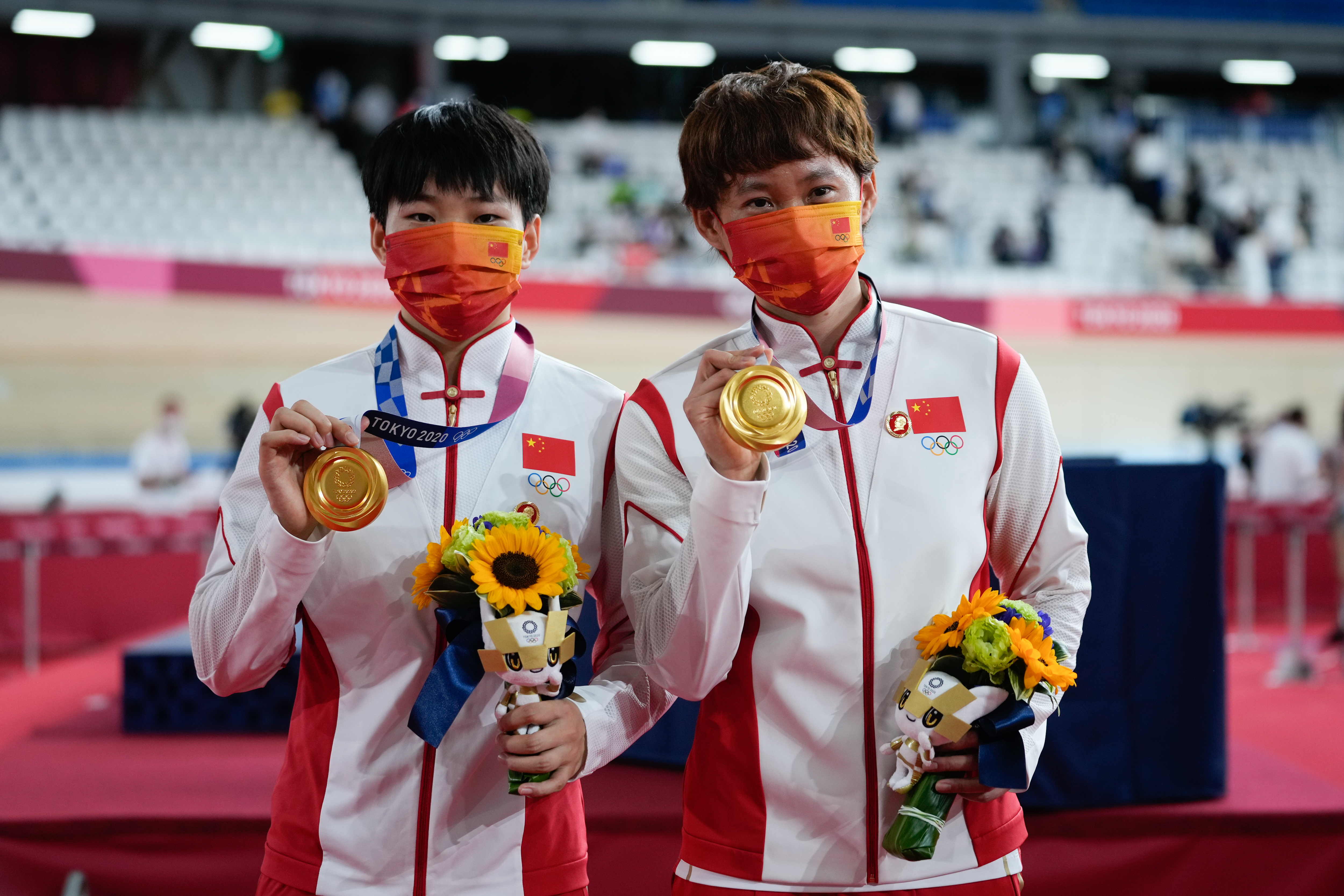 Gold medalists Zhong Tianshi and Bao Shanju of Team China pose during the medal ceremony for the women's team sprint track cycling finals  on day ten of the Tokyo Olympics on Aug 2, 2021 in Izu, Shizuoka, Japan.