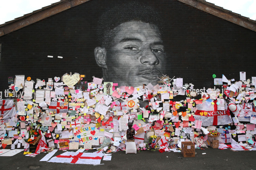 A mural depicting England footballer Marcus Rashford, one of the targets of racist abuse on Twitter in the wake of the Euro 2020 Final, adorned with supportive messages. Pictured  July 14, 2021 in Manchester, England.