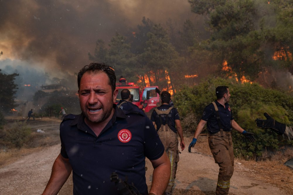 Firefighters battle a wildfire in Mugla, Marmaris district, Turkey, on Aug. 2. Turkey's struggles against its deadliest wildfires in decades come as a blistering heatwave grips southeastern Europe.