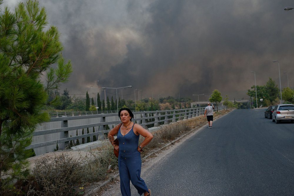 Forest fire rages in Varybobi, north of Athens, Greece on Aug. 3. Residential areas in Athens northern suburbs were evacuated as wildfires reached the outskirts of the city.