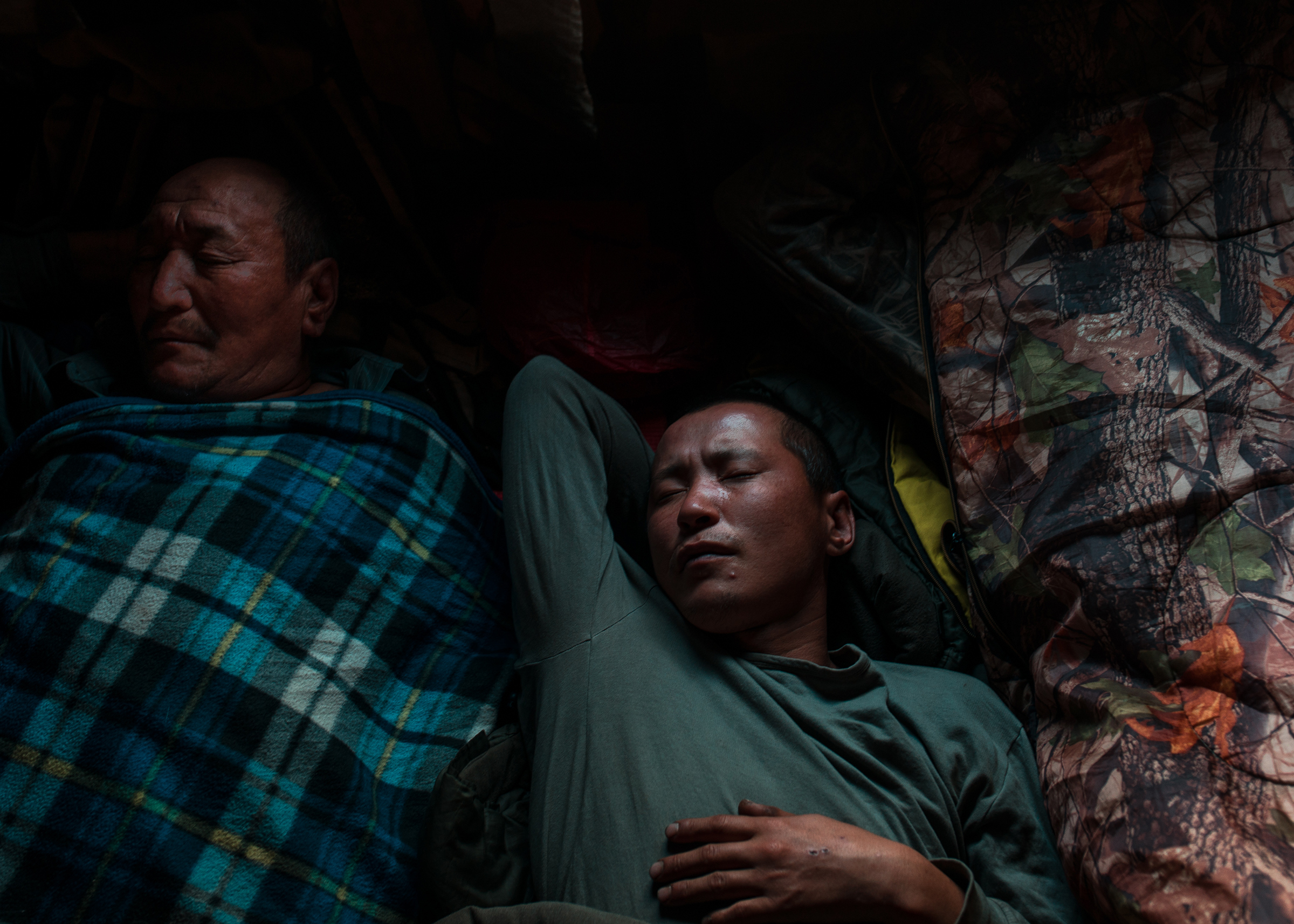 Local firefighting volunteers sleep in a small hut near the village of Magaras in the Gorny District of Russia.