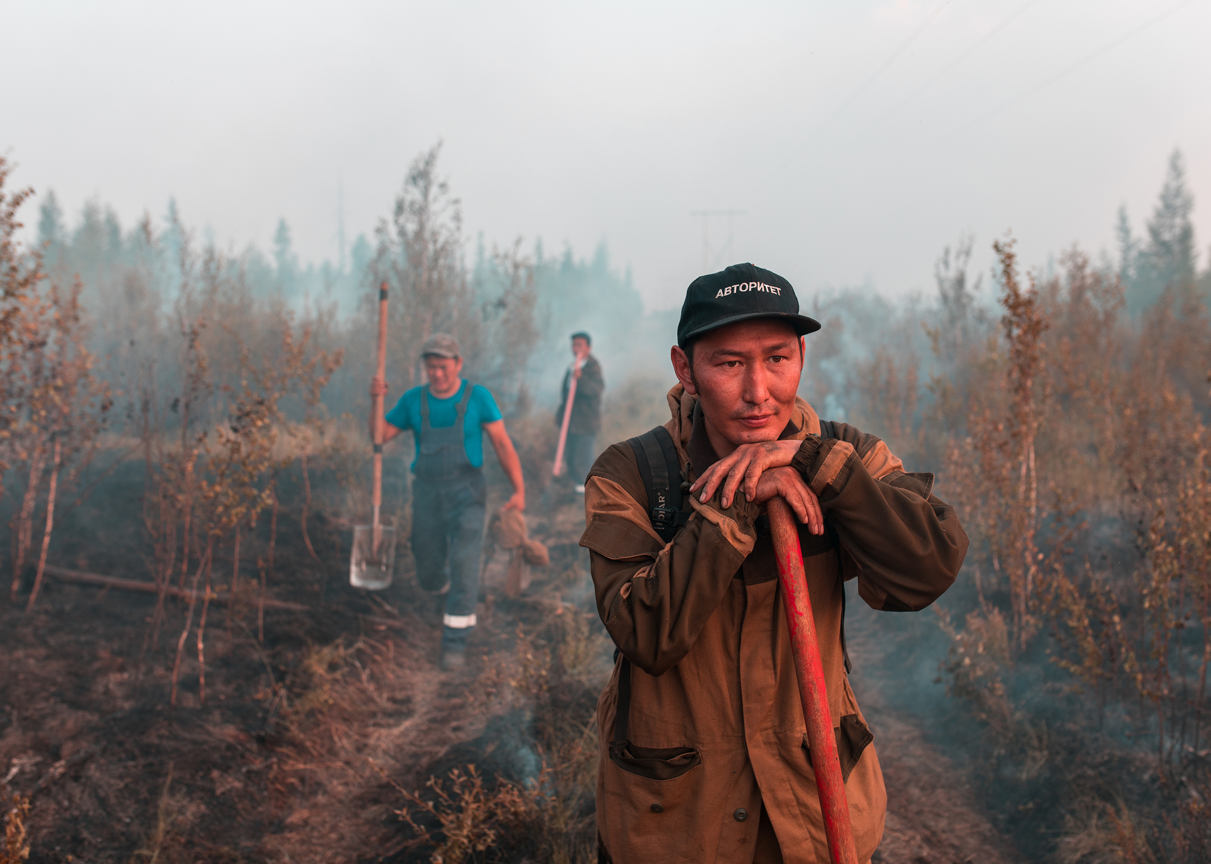 Alexander Yakovlev, 40, a volunteer from the village of Kyuerelyakh, together with his 18-year-old son Markel, has been working to extinguish wildfires near his home since early in the summer.