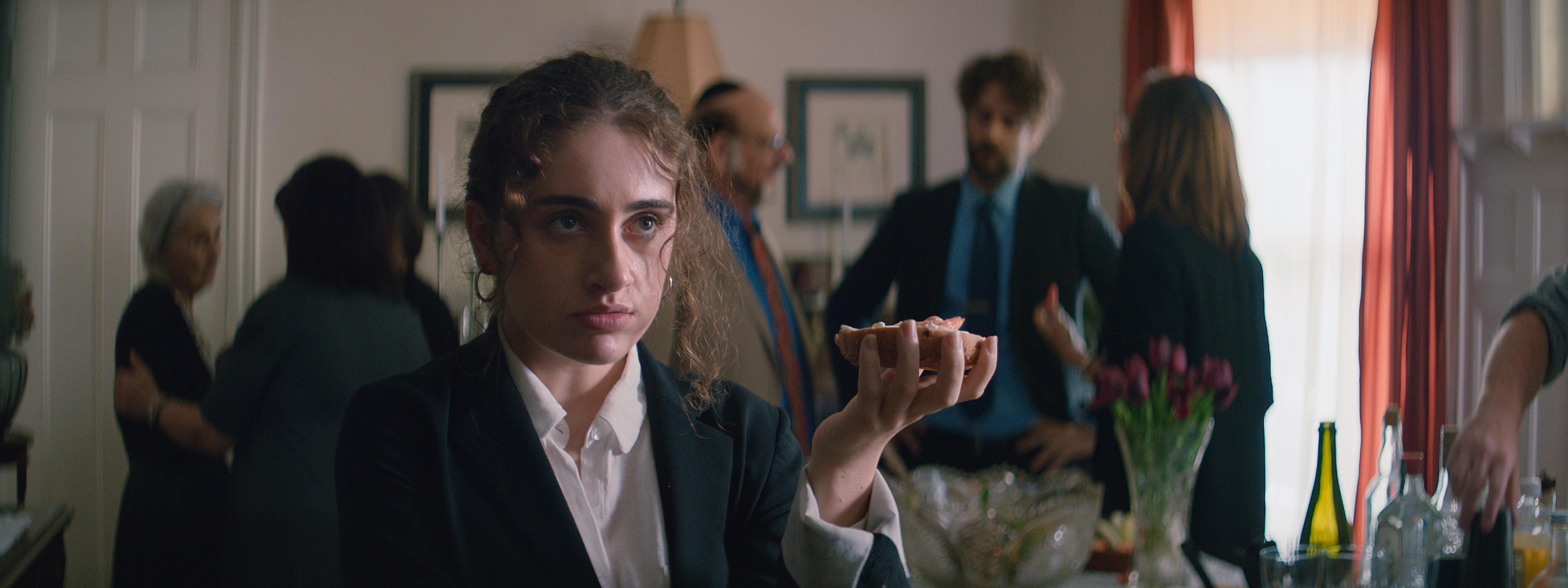 Rachel Sennott eats a bagel and lox in 'Shiva Baby'