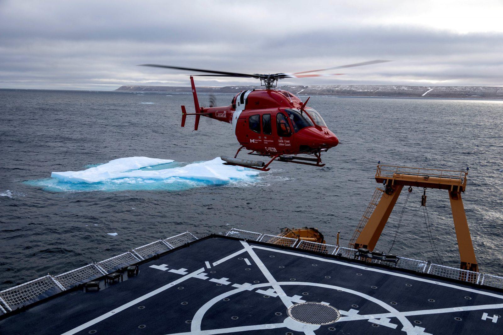 A Canadian coast guard helicopter lands aboard the U.S. Coast Guard Cutter Healy near Resolute, Nunavut, Canada on Sept. 6, 2021.