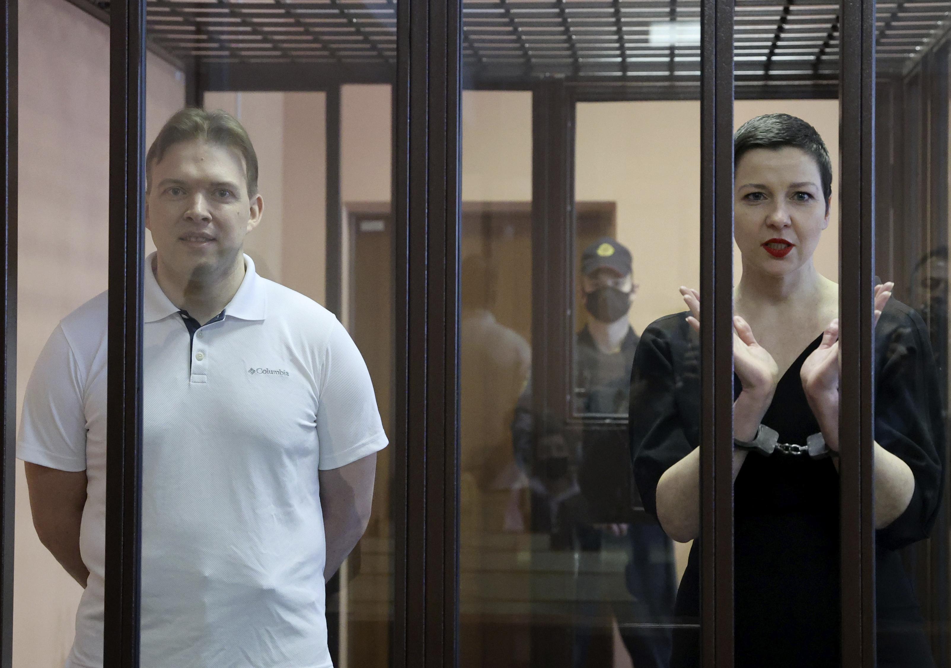 Belarus' opposition activists Maria Kolesnikova, right, and Maxim Znak attend a court hearing in Minsk, Belarus, Monday, Sept. 6, 2021.