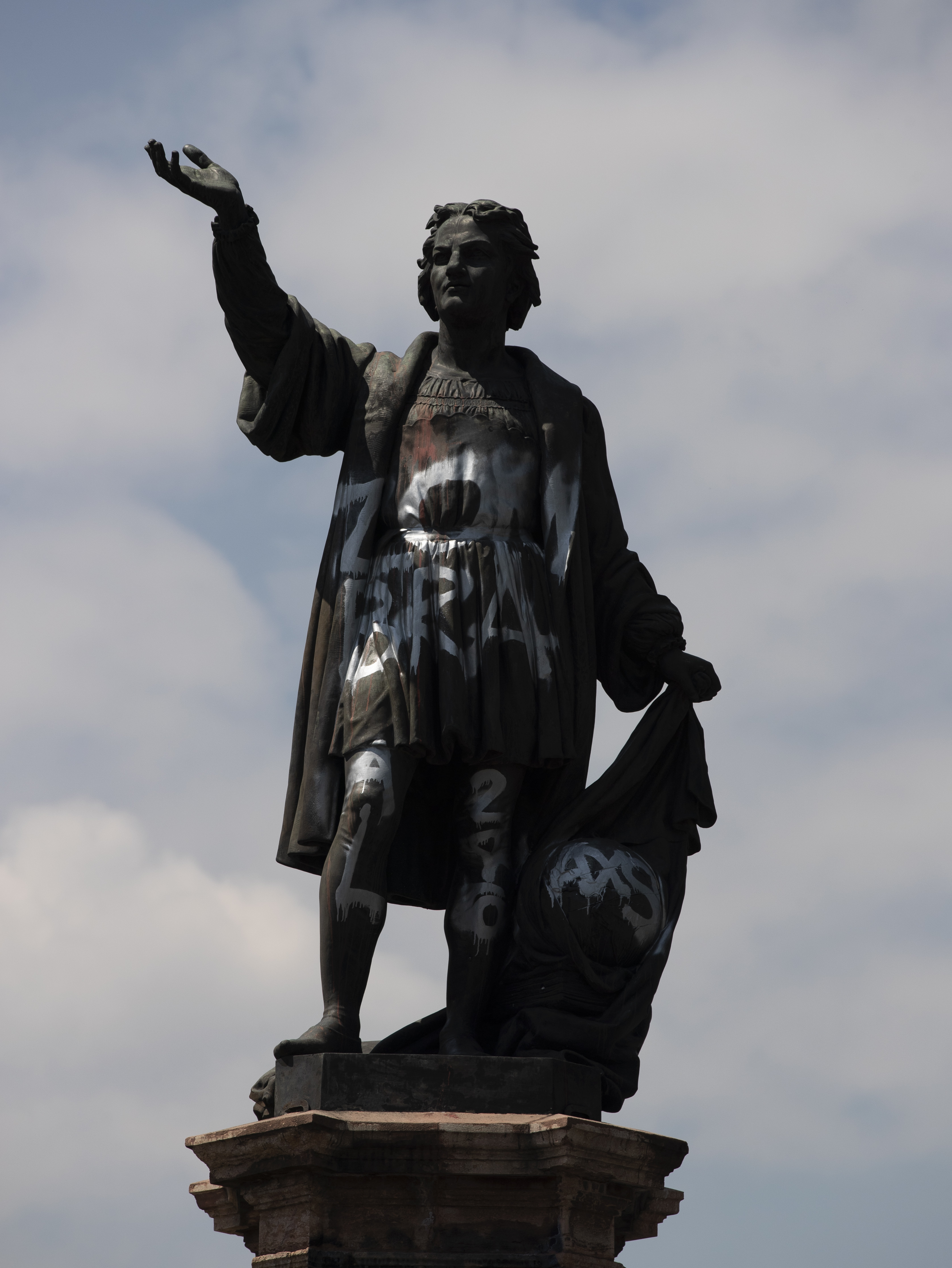 In this Sept. 28, 2020 file photo, a defaced statue of Christopher Columbus stands on Paseo de la Reforma in Mexico City.
